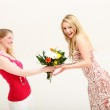 Vivacious woman receiving floral gift — Stock Photo