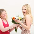 Woman exclaiming over a gift of flowers — Stock Photo #11274932