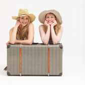 Happy tourists with their suitcase — Stock Photo