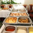 Stock Photo: Hot buffet meal displayed in metal dishes