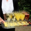 Waiter serving a tray of champagne — Stock Photo
