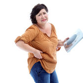 Women who are overweight holding scales in her hand and looks sad — Stock Photo