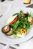 Variety of appetizers with rocket — Stock Photo