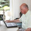 Senior man working on a laptop — Stock Photo