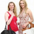 Two female friends out shopping — Foto de Stock
