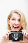 Smiling woman with vintage photo camera — Stock Photo