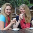 Female friends enjoying iced coffee — Stock Photo
