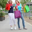 Excited women with their purchases — Stock Photo