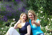 Happy motivated friends giving thumbs up — Stock Photo