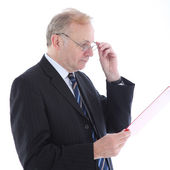 Serious businessman reading report — Stock Photo