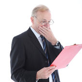 Appalled businessman reading report — Stock Photo