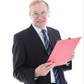 Smiling middle-aged man with clipboard — Stock Photo