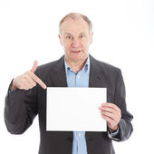 Businessman pointing to blank card — Stock Photo