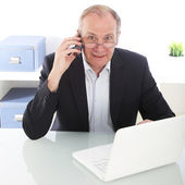 Hardworking businessman on mobile — Stock Photo