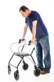 Despondent man on medical walker — Stock Photo