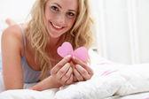 Romantic woman with Valentine hearts — Stock Photo