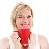 Happy woman with large red mug of coffee — Stock Photo