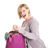 Ecstatic shopaholic with full carrier bag — Stock Photo