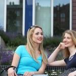 Two women relaxing chatting — Stock Photo