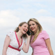 Two woman listening to a phone call — Stock Photo