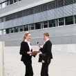 Stock Photo: Female business executives outside offices