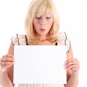 Woman looking at blank sign in admiration — Stock Photo