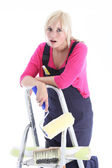 Tired woman doing wallpapering — Stock Photo