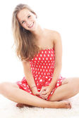 Beautiful teenager sitting crosslegged — Stock Photo