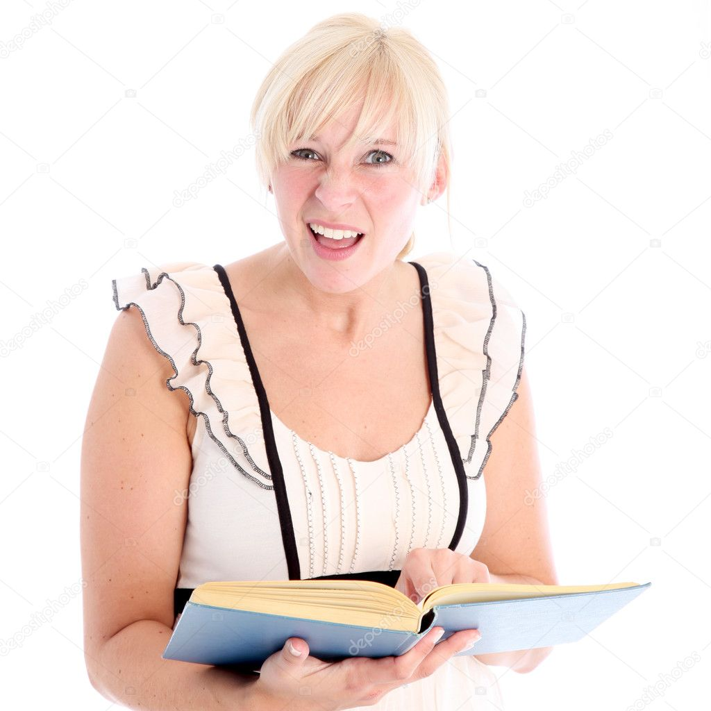 Woman with bemused expression looking something up in a book she is handholding isolated on white  Stock Photo #12242429