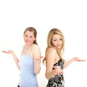 Easy going women shrugging in indifference — Stock Photo