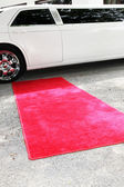 Limousine and red carpet — Stock Photo
