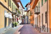 Old colorful street in Alba, Northern Italy. — Stock Photo