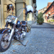 Motorcycle on the street. Alba, Italy. - Stock Photo