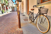 Bicycle on the street of Alba, Italy. — Stock Photo