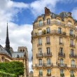 Parisian building and Notre Dame de Paris. — Stock Photo