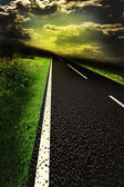 Asphalt road and red bloody blurred sky with sun — Stock Photo