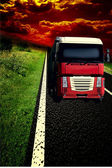 Truck on asphalt road under storm sky with clouds — Stock Photo