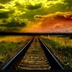 Old railway to sunset — Stock Photo