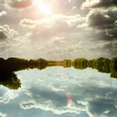 Calm beautiful landscape with lake and sky reflected in water — Stock Photo