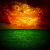 A fine green meadow All on storm sky sunset — Stock Photo