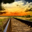 Railway into the sunset - Stock Photo