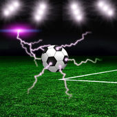 Soccer ball on the green field with lightnings — Stock Photo
