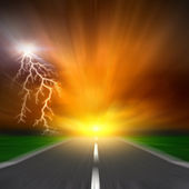 The blurred asphalt road with storm lightning on sky — Stock Photo