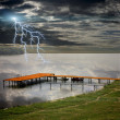 Boat station on the beautiful lake and storm lightnings — Stock Photo
