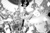 Beautiful crystal chandelier in a room. Close up on the crystal — Stock Photo