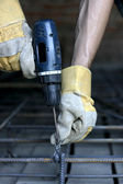 Worker making reinforcement metal framework for concrete pouring — Stock Photo