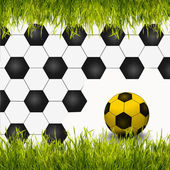 A soccer ball with green grass as creative background — Stock Photo