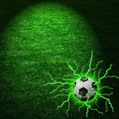 Football ball with blue lightning over rays — Stock Photo