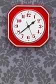 Red vintage kitchen clock — Stock Photo