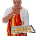 Female senior with cookies — Stock Photo #11734352